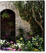 Italian Front Door Adorned With Flowers Canvas Print by Marilyn Hunt