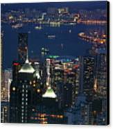 Kowloon Skyline And Victoria Harbour At Dusk Canvas Print by Sami Sarkis