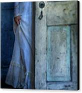 Lady In Vintage Clothing Hiding Behind Old Door Canvas Print by Jill Battaglia