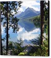 Lake Mcdlonald Through The Trees Glacier National Park Canvas Print by Marty Koch