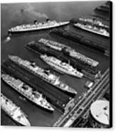 Luxury Liners Flanking An Aircraft Canvas Print by Everett