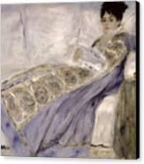 Madame Monet On A Sofa Canvas Print by Pierre Auguste Renoir