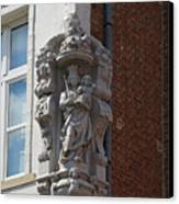 Madonna And Child Statue On The Corner Of A House In Bruges Canvas Print by Louise Heusinkveld