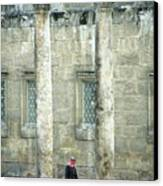 Man Walking Between Columns At The Roman Theatre Canvas Print by Sami Sarkis