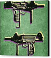 Mini Uzi Sub Machine Gun On Green Canvas Print by Michael Tompsett