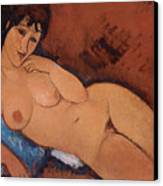 Nude On A Blue Cushion Canvas Print by Amedeo Modigliani
