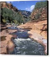 Oak Creek Flowing Through The Red Rocks Canvas Print by Rich Reid