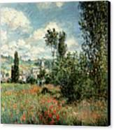 Path Through The Poppies Canvas Print by Claude Monet
