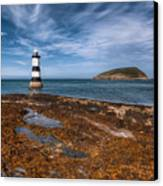Penmon Lighthouse Canvas Print by Adrian Evans