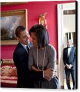 President Obama Hugs First Lady Canvas Print by Everett