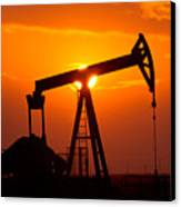 Pumping Oil Rig At Sunset Canvas Print by Connie Cooper-Edwards
