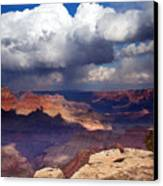 Rain Over The Grand Canyon Canvas Print by Mike  Dawson