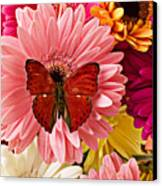 Red Butterfly On Bunch Of Flowers Canvas Print by Garry Gay