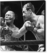 Rocky Marciano Landing A Punch Canvas Print by Everett