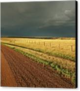 Storm Clouds Along A Saskatchewan Country Road Canvas Print by Mark Duffy