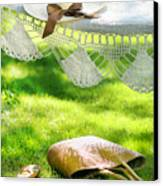 Straw Hat With Brown Ribbon Laying On Hammock Canvas Print by Sandra Cunningham