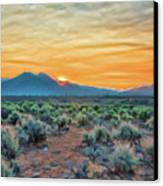 Sunrise Over Taos Canvas Print by Charles Muhle