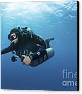 Technical Diver With Equipment Swimming Canvas Print by Karen Doody