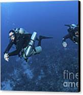 Technical Divers With Equipment Canvas Print by Karen Doody