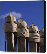 The Strangely Shaped Rooftop Chimneys Canvas Print by Taylor S. Kennedy