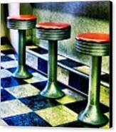 Three White Steamer Stools Canvas Print by Julie Dant