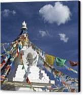 Tibetan Stupa With Prayer Flags Canvas Print by Michele Burgess