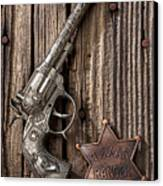 Toy Gun And Ranger Badge Canvas Print by Garry Gay