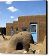 Tres Casitas Taos Pueblo Canvas Print by Kurt Van Wagner