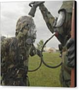 U.s. Air Force Soldier Decontaminates Canvas Print by Stocktrek Images