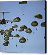 U.s. Army Paratroopers Jumping Canvas Print by Stocktrek Images
