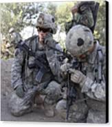 U.s. Army Soldier Radios In His Teams Canvas Print by Stocktrek Images