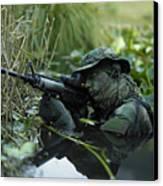 U.s. Navy Seal Crosses Through A Stream Canvas Print by Tom Weber