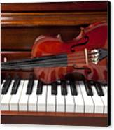 Violin On Piano Canvas Print by Garry Gay