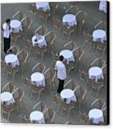 Waiters At Empty Cafe Terrace On Piazza San Marco Canvas Print by Sami Sarkis