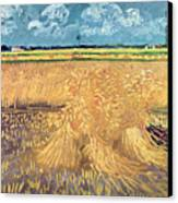Wheatfield With Sheaves Canvas Print by Vincent van Gogh