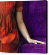Young Woman In Red On Purple Couch Canvas Print by Jill Battaglia