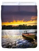 Boat on lake at sunset Duvet Cover by Elena Elisseeva
