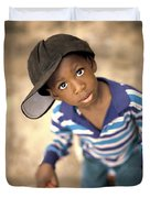 Boy Wearing Over Sized Hat Riding Bike Duvet Cover by Ron Nickel