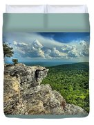Face In The Cliff Duvet Cover by Adam Jewell