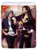 Fashionably Dressed Boy And Teenage Girl Under Falling Autumn Le Duvet Cover by Oleksiy Maksymenko