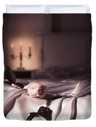 Handcuffs And A Rose On Bed Duvet Cover by Oleksiy Maksymenko