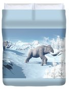 Mammoths Walking Slowly On The Snowy Duvet Cover by Elena Duvernay