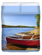 Red Canoe On Shore Duvet Cover by Elena Elisseeva