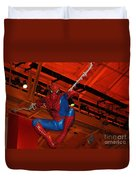 Spiderman Swinging Through The Air Duvet Cover by John Telfer