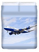 United Airlines Boeing 747 Airplane Flying Duvet Cover by Paul Velgos
