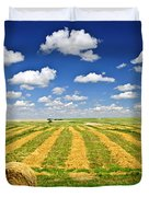 Wheat farm field and hay bales at harvest in Saskatchewan Duvet Cover by Elena Elisseeva