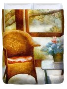 Wicker Chair and Cyclamen Duvet Cover by Michelle Calkins