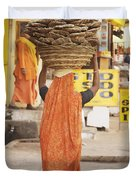 Woman Carrying Cow Dung In Basket On Duvet Cover by Paul Miles