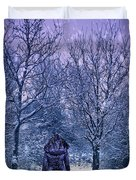 Woman Walking In Snow Duvet Cover by Amanda And Christopher Elwell