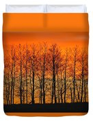 Silhouette Of Trees Against Sunset Duvet Cover by Don Hammond
